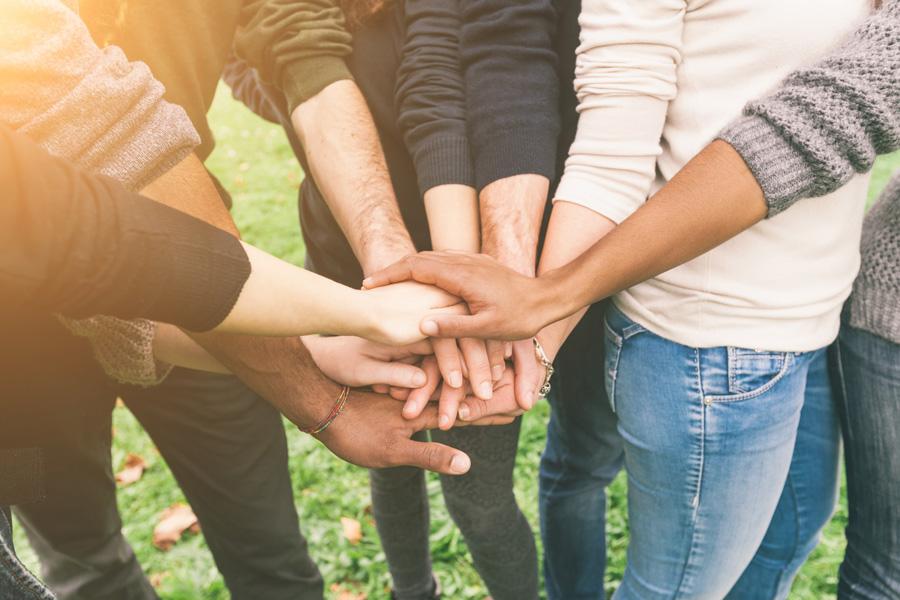 volunteers uniting hands